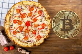 8 years ago, a programmer paid 10,000 bitcoins for 2 Papa John's pizzas — now it's the most celebrated day in crypto